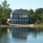 Lakefront waterfront cottage home for sale in Southwest Michigan near South Haven and St Joseph with Private Sandy Beach