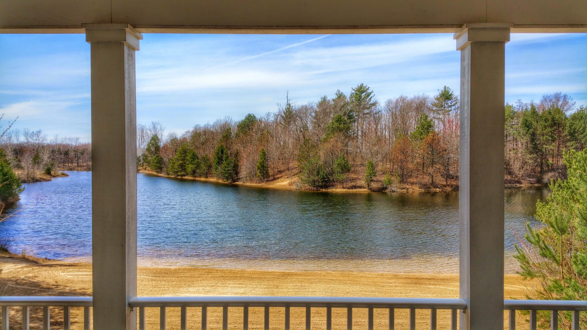 Wrap Your Lakefront House Around This Covered Porch